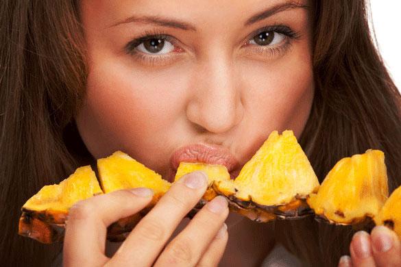 More Reasons to Eat Pineapple_woman sucking pineapple